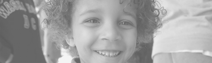 smiling young boy with curly hair